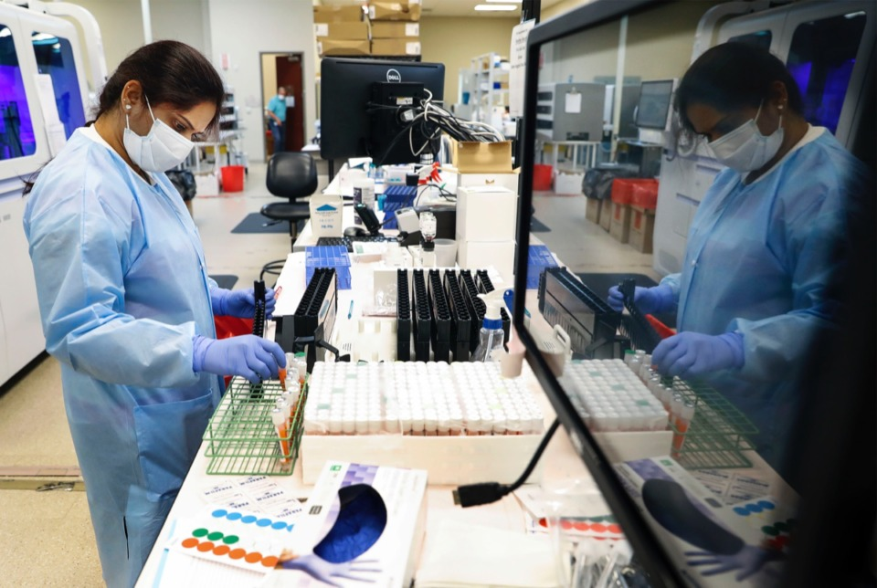 <strong>Poplar Healthcare technician Lakshmi Nellore logs tested COVID-19 samples on Monday, July 6, 2020.</strong> (Mark Weber/Daily Memphian file)