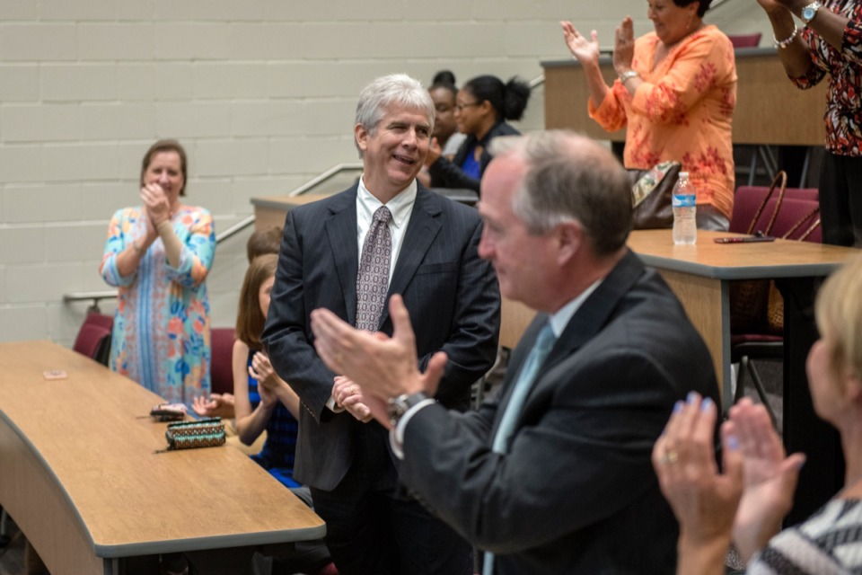 <strong>Gary Lilly, center, receives applause after being named the new superintendent of Collierville schools in May 2019. He said July 28 that reopening schools is &ldquo;complex&rdquo; with no simple solutions.&nbsp;</strong>(Daily Memphian file)