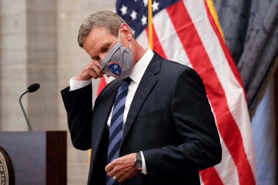 <strong>Gov. Bill Lee seems aware of the need for masks and social distancing in this July 1 photo, but doesn&rsquo;t seem to think those measures are necessary when it comes to high school football.</strong> (Mark Humphrey/AP file)