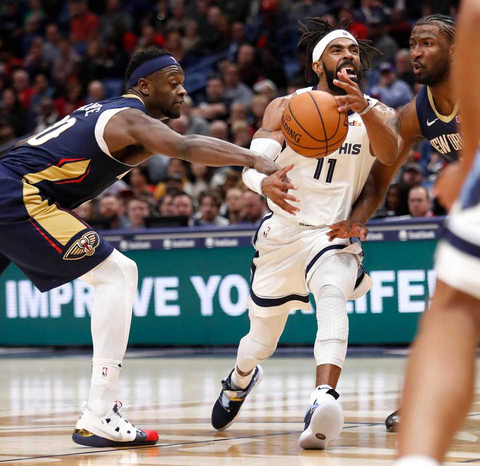 <span><strong>Memphis Grizzlies guard Mike Conley (11) has the ball stripped by New Orleans Pelicans forward Julius Randle (30) in the first half of an NBA basketball game in New Orleans, Friday, Dec. 7, 2018.</strong> (AP Photo/Tyler Kaufman)</span>