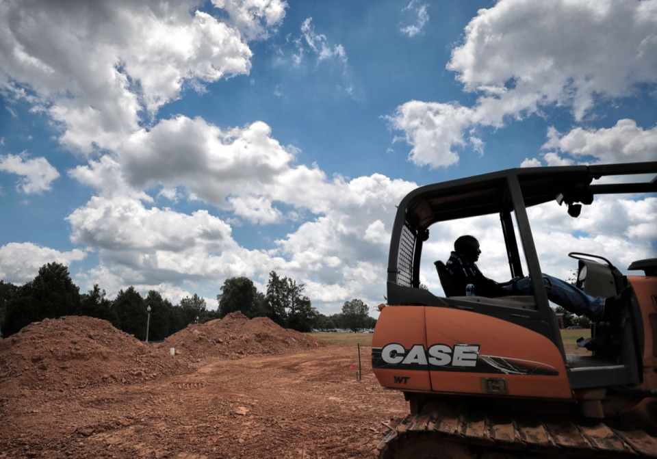 <strong>Oliver Bell with Drus Landscaping waits for his crew to arrive to continue groundwork for a new Pinnacle Bank branch on Kirby-Whitten Road in Bartlett on June 20, 2019.</strong> (Jim Weber/Daily Memphian file)