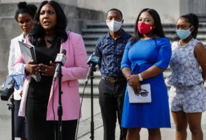 <strong>State Sen. Katrina Robinson (second right) attends a press conference with her family and attorneys on the steps of the D&rsquo;Army Bailey Courthouse on Wednesday, July 29. Robinson has been charged with theft and embezzlement involving government programs and wire fraud. She allegedly stole more than $600,000 from her business, The Healthcare Institute.</strong> (Mark Weber/Daily Memphian)
