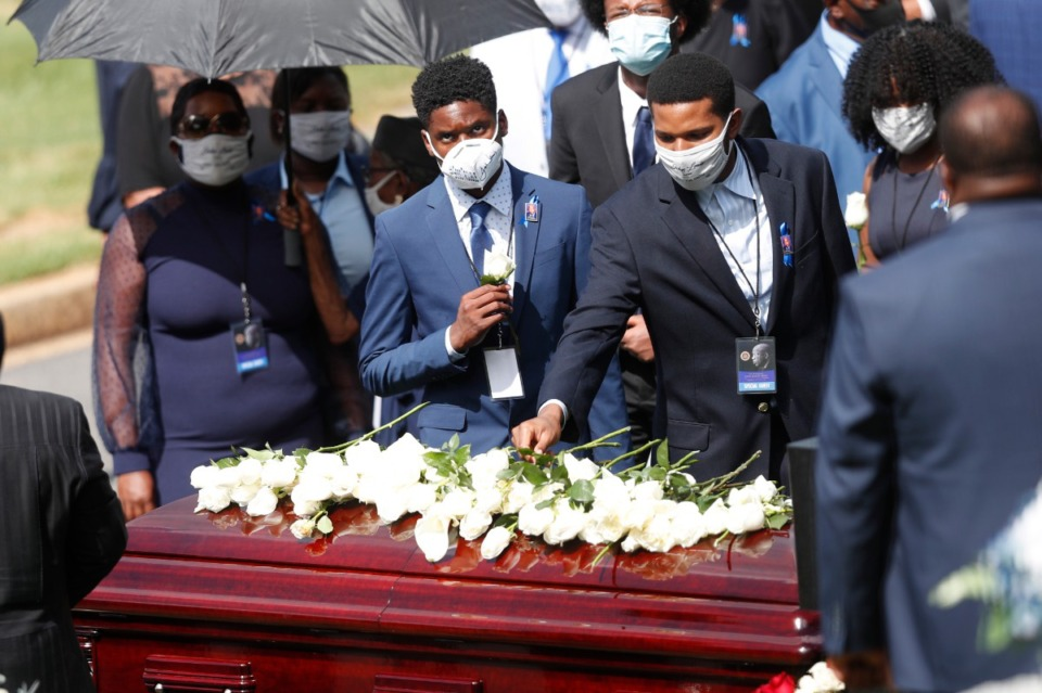 <strong>Mourners place flowers on the casket of Rep. John Lewis at South-View Cemetery, Thursday, July 30, 2020, in Atlanta. Lewis, who carried the struggle against racial discrimination from Southern battlegrounds of the 1960s to the halls of Congress, died Friday, July 17, 2020.</strong> (John Bazemore/AP)