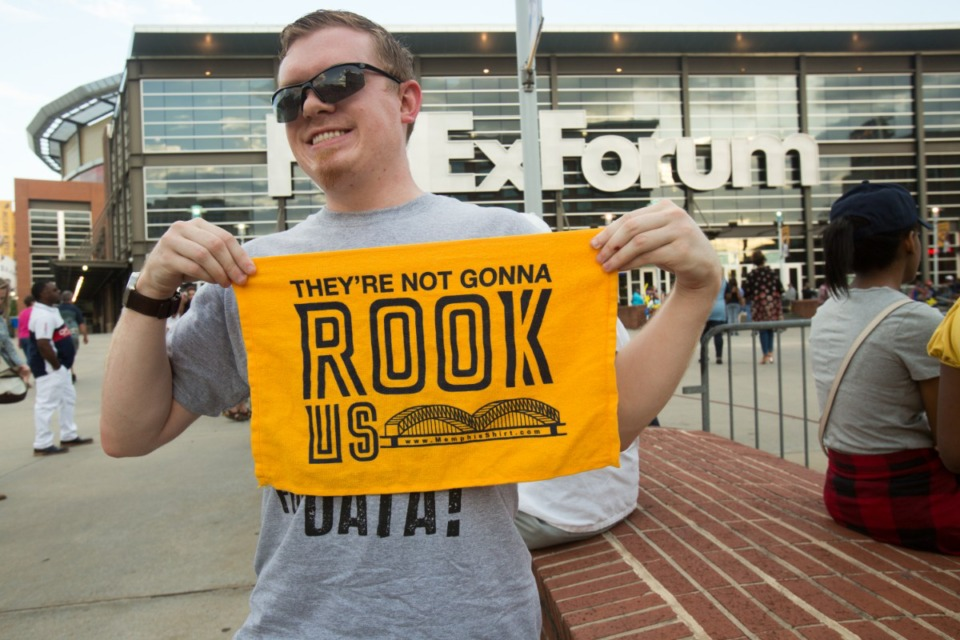 <strong>Kevin Brower poses with his growl towel before game three of the Grizzlies playoffs series in 2017.</strong> (Daily Memphian file)
