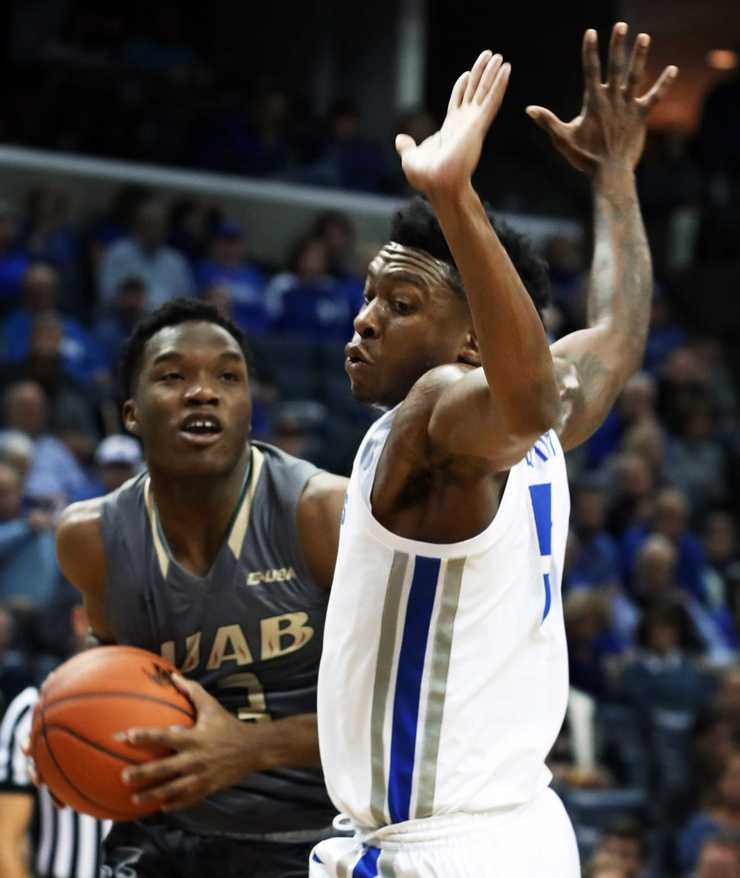 <strong>UAB guard Tavin Lovan tries to get around University of Memphis guard Kareem Brewton Jr. during a game Saturday, Dec. 8, 2018, at FedExForum. </strong>(Karen Pulfer Focht/Special to The Daily Memphian)