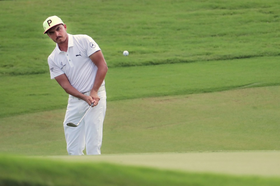 <strong>Rickie Fowler chips in a birdie on the first day of the WGC-FedEx St. Jude Invitational at TPC Southwind. </strong>(Patrick Lantrip/Daily Memphian)