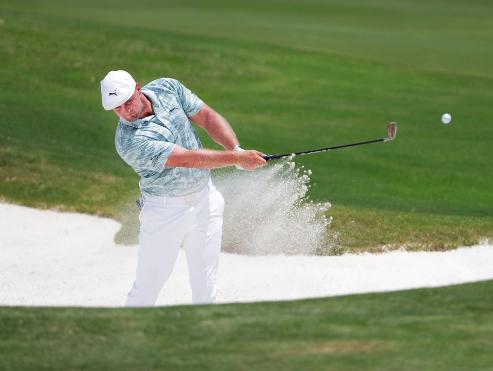 <strong>Bryson DeChambeau tries to blast out of a bunker during the second day of the WGC-FedEx St. Jude Invitational at TPC Southwind in Memphis on Friday, July 31.</strong> (Patrick Lantrip/Daily Memphian)