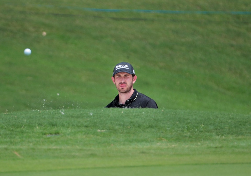 <strong>Patrick Cantlay stares down his ball as he tries to chip out of a deep bunker on the 18th hole during the second day of the WGC-FedEx St. Jude Invitational at TPC Southwind in Memphis on Friday, July 31.</strong> (Patrick Lantrip/Daily Memphian)