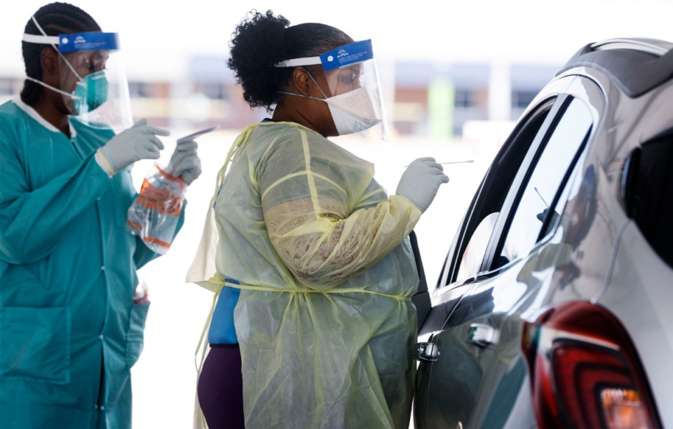 <strong>Christ Community Health Center medical staff collect nasal swabs as hundreds of Memphians line up for COVID-19 testing at their site in Hickory Hill on July 14, 2020.</strong> (Mark Weber/Daily Memphian)