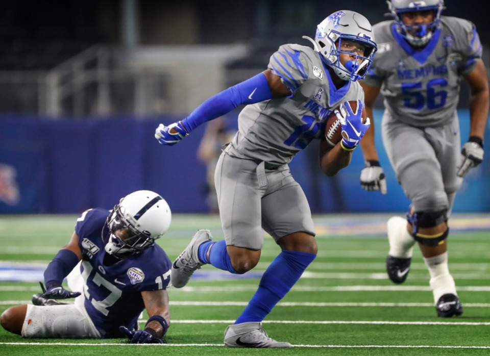 <strong>Memphis running back Kenneth Gainwell (center) runs for a first down past Penn State defender Garrett Taylor (left) during action at the Cotton Bowl Dec. 28, 2019, at AT&amp;T Stadium in Arlington, Texas.</strong> (Mark Weber/Daily Memphian file)