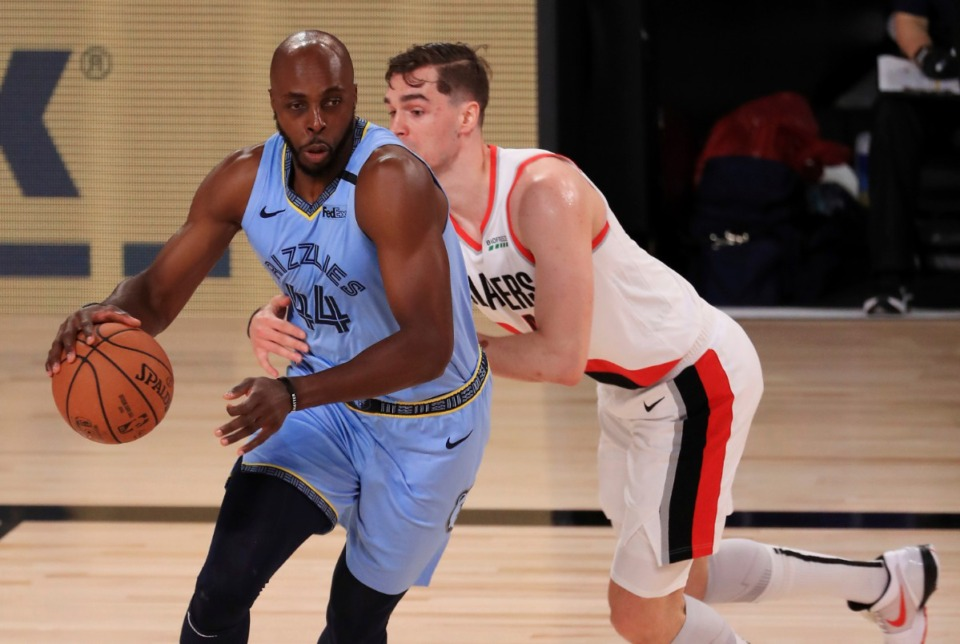 <strong>Memphis Grizzlies Anthony Tolliver (44) dribbles against Portland Trail Blazers Mario Hezonja (44) during the second half of an NBA basketball game Friday, July 31, 2020, in Lake Buena Vista, Fla.</strong> (Mike Ehrmann/AP)