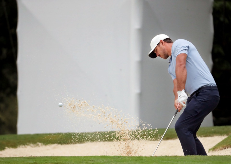 <strong>Brooks Koepka punches the ball out of a bunker during the third round of the WGC-FedEx St. Jude Invitational in Memphis, Tennessee, Aug. 1, 2020.</strong> (Patrick Lantrip/Daily Memphian)