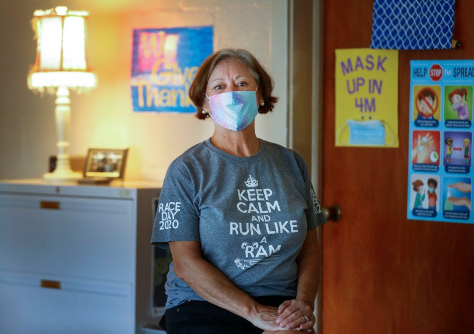 "<strong>Nora McGowan, a teacher at Holy Rosary, readies her classroom on Wednesday, July 29, 2020, as she prepares for her students to return to the classroom next month. ""I'm not scared,"" she said, but as someone who several months ago didn't always wear a face mask to the grocery store, she also admits she has much more respect for COVID-19 than she once did. McGowan lost older brother Tom Marino, former Bartlett High football coach, to COVID-19 and suspects it played a role in the death of her other brother, Steve.</strong> (Mark Weber/Daily Memphian)"