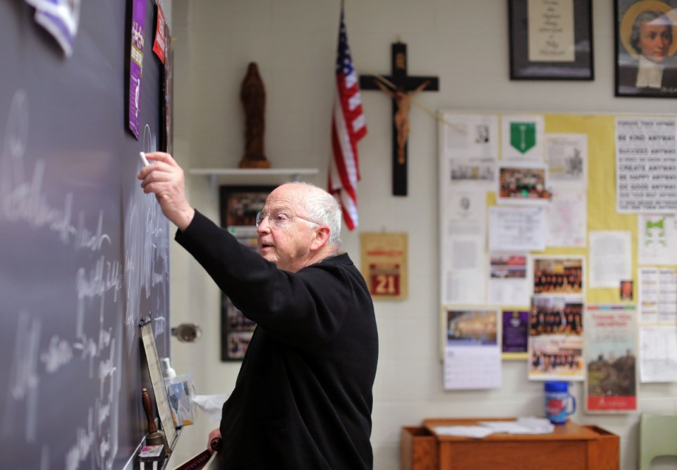 <strong>Brother Joel McGraw writes notes on the chalkboard at Christian Brothers High Feb. 21, 2020, shortly before the coronavirus shut everything down.</strong> (Patrick Lantrip/Daily Memphian file)