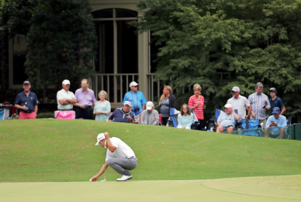 <strong>Kang Sung-hoon places his ball on the 10th green while fans watch from a back yard during the third round of the WGC-FedEx St. Jude Invitational in Memphis, Tennessee, Aug. 1, 2020.</strong> (Patrick Lantrip/Daily Memphian)