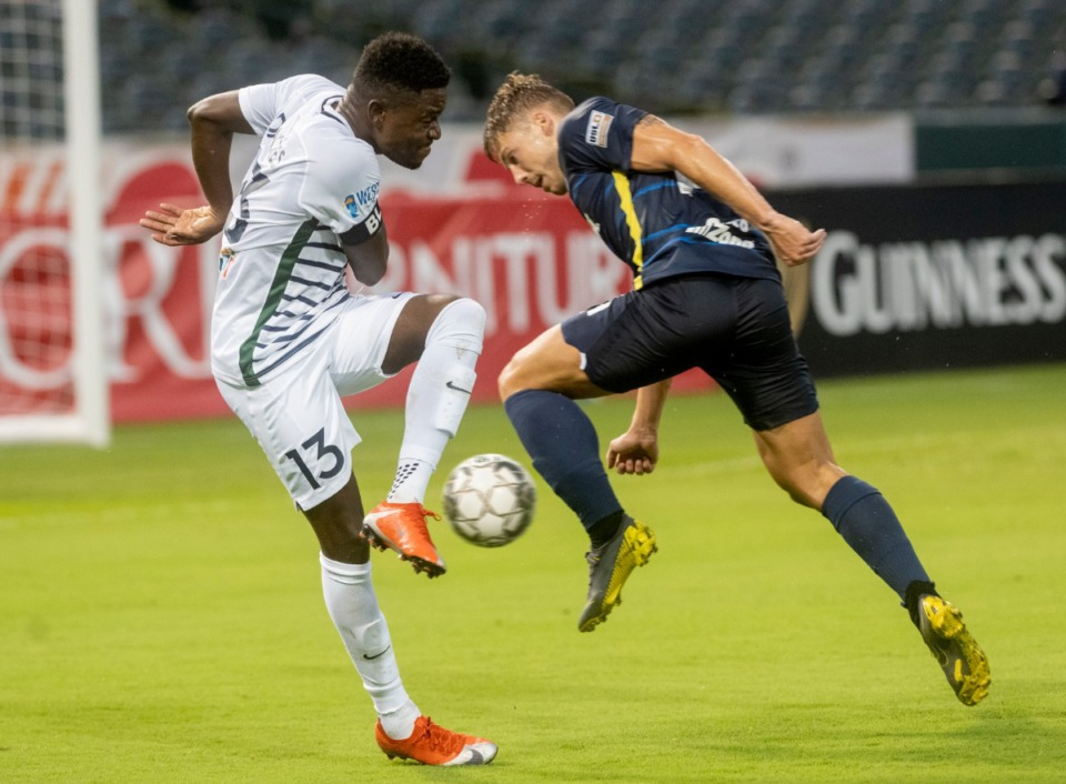<strong>Memphis 901 FC forward Rafael Mentzingen battles St. Louis' defender Kadeem Dacres at AutoZone Park Saturday, August 1, 2020. Memphis won the match 1-0.</strong> (Greg Campbell/Special to The Daily Memphian)
