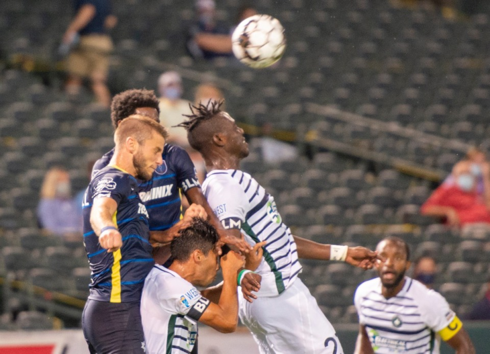 <strong>Memphis 901 FC defenders Zach Carroll and Mark Segbersat battle for the ball against St. Louis FC's Oluwatobilba Adewole at AutoZone Park Saturday, August 1, 2020. </strong>(Greg Campbell/Special to The Daily Memphian)