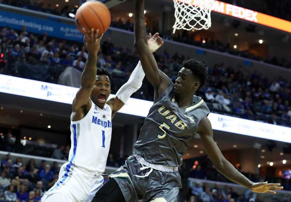 "<strong>University of Memphis guard Tyler Harris (1) goes up for a basket guarded by UAB's Makahtar Gueve (5) in the second half </strong><span class=""s1""><strong>of the Saturday, Dec. 8, 2018, game at FedExForum.<span class=""Apple-converted-space""> </span></strong>(Karen Pulfer Focht/Special to The Daily Memphian)</span>"
