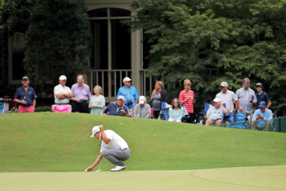<strong>Kang Sung-hoon places his ball on the 10th green while fans watch from a backyard during the third round of the WGC-FedEx St. Jude Invitational in Memphis, Tennessee Aug. 1, 2020.</strong> (Patrick Lantrip/Daily Memphian)