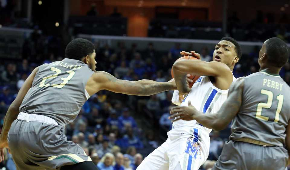 "<strong>University of Memphis guard Antwann Jones (11) keeps the ball back from UAB's Lewis Sullivan (23) and Jalen Perry (21) </strong><span class=""s1""><strong>during a game Saturday, Dec. 8, 2018, at FedExForum.</strong> (Karen Pulfer Focht/Special to The Daily Memphian)</span>"