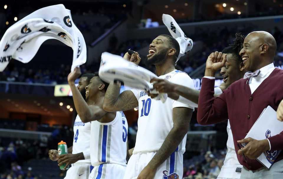 "<strong>University of Memphis players rejoice at the end of the game against UAB on Saturday, Dec. 8, 2018, as the Tigers win 94-76. </strong><span class=""s1"">(Karen Pulfer Focht/Special to The Daily Memphian)</span>"
