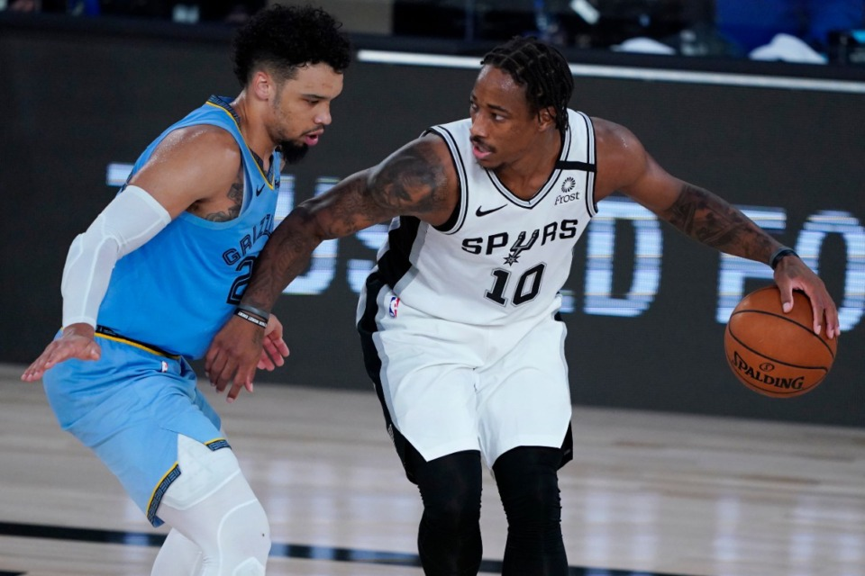 <strong>San Antonio Spurs' DeMar DeRozan (10) dribbles up the court against Memphis Grizzlies' Dillon Brooks (24) during the second half of an NBA basketball game Sunday, Aug. 2, 2020, in Lake Buena Vista, Fla.</strong> (Ashley Landis/APl)