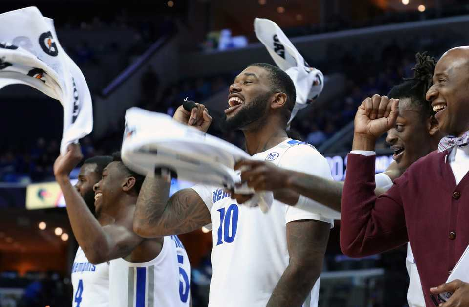 "<strong>University of Memphis players rejoice at the end of the game against the UAB Blazers as the Tigers win 94-76 on </strong><span class=""s1""><strong>Saturday, Dec. 8, 2018, at FedExForum.</strong> (Karen Pulfer Focht/Special to The Daily Memphian)</span>"