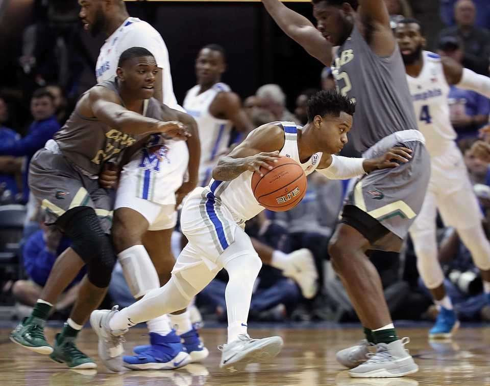 "<p class=""p1""><span class=""s1""><b>University of Memphis guard Tyler Harris ducks around UAB's Jalen Perry (left) and Will Butler (right) during a matchup Saturday, Dec. 8, 2018, at FedExForum in Memphis.</b> (Karen Pulfer Focht/Special to The Daily Memphian)</span>"