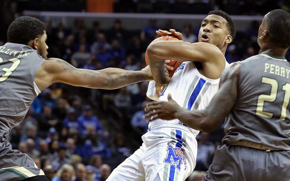 "<strong>University of Memphis guard Antwann Jones (11) keeps the ball away from UAB's Lewis Sullivan (23) and Jalen Perry (21)&nbsp;</strong><span class=""s1""><strong>during a game Saturday, Dec. 8, 2018, at FedExForum.</strong> (Karen Pulfer Focht/Special to The Daily Memphian)</span>"