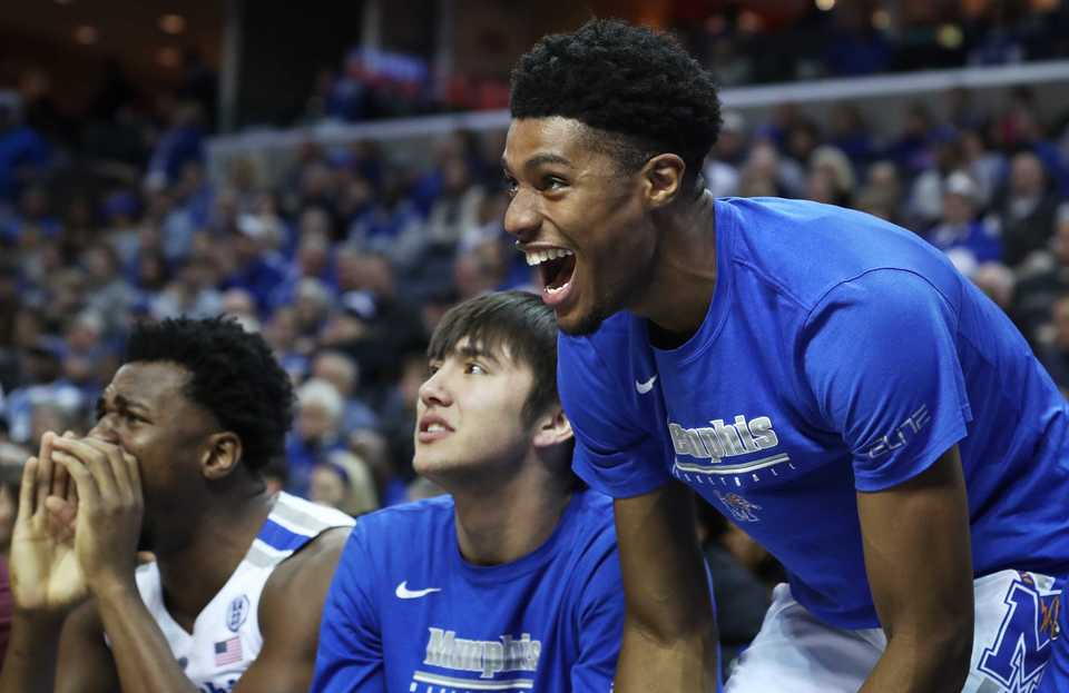"<p class=""p1""><span class=""s1""><b>University of Memphis guard Ryan Boyce (left) and his teammates cheer from the bench&nbsp;during the Tigers game on Saturday, Dec. 8, 2018, against UAB at FedExForum.</b> (Karen Pulfer Focht/Special to The Daily Memphian)</span>"