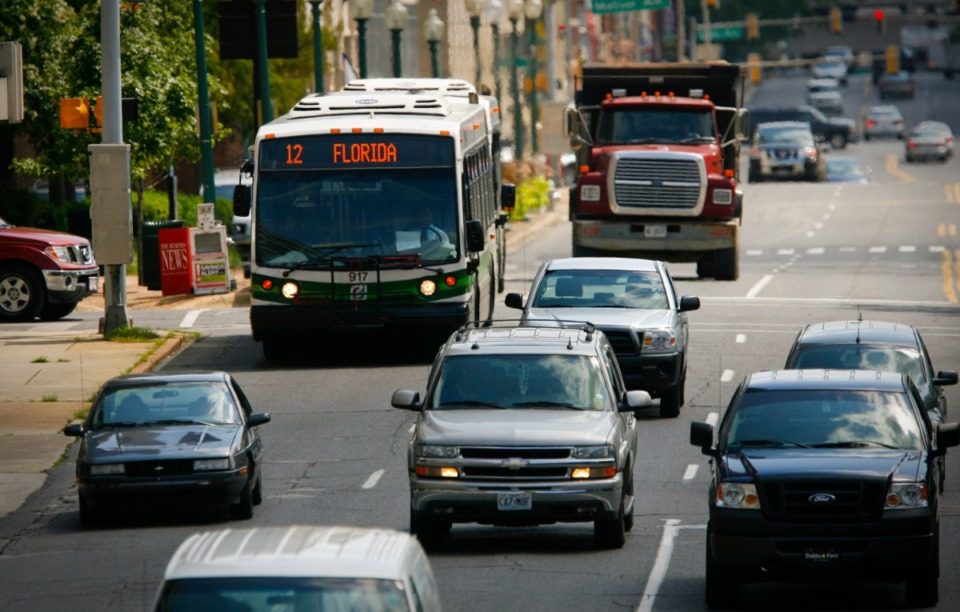 <strong>Traffic moves along Front Street near City Hall in 2019. A developer has proposed a $30 million project at Front and Vance.</strong> (Daily Memphian file)