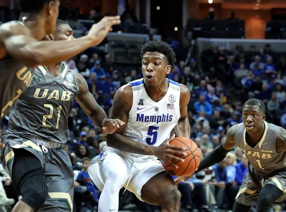 "<strong>University of Memphis guard Kareem Brewton Jr. (5) maneuvers around UAB defenders Jalen Perry (21) and Zack Bryant (1) in the second half of a game on&nbsp;</strong><span class=""s1""><strong>Saturday, Dec. 8, 2018, at FedExForum.</strong> (Karen Pulfer Focht/Special to The Daily Memphian)</span>"