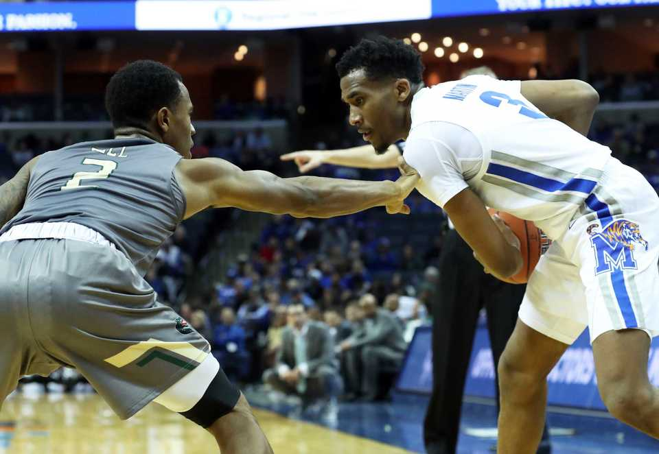 "<strong>University of Memphis guard Jeremiah Martin (3) keeps the ball out of reach from UAB's Jeremiah Bell (2) in the second half of the Tigers matchup against the Blazers on&nbsp;</strong><span class=""s1""><strong>Saturday, Dec. 8, 2018, at FedExForum.<span class=""Apple-converted-space"">&nbsp; </span></strong>(Karen Pulfer Focht/Special to The Daily Memphian)</span>"