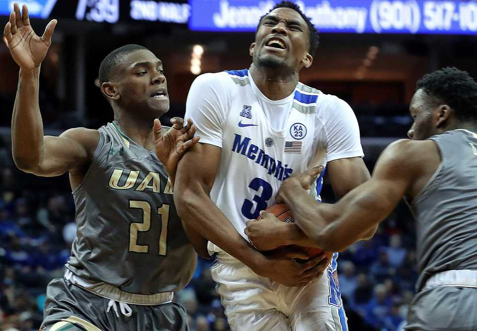 "<strong>University of Memphis guard Jeremiah Martin (3) holds onto the ball as UAB's Jalen Perry (21) moves in during the second half of the matchup on </strong><span class=""s1""><strong>Saturday, Dec. 8, 2018, at FedExForum. </strong>(Karen Pulfer Focht/Special to The Daily Memphian)</span>"