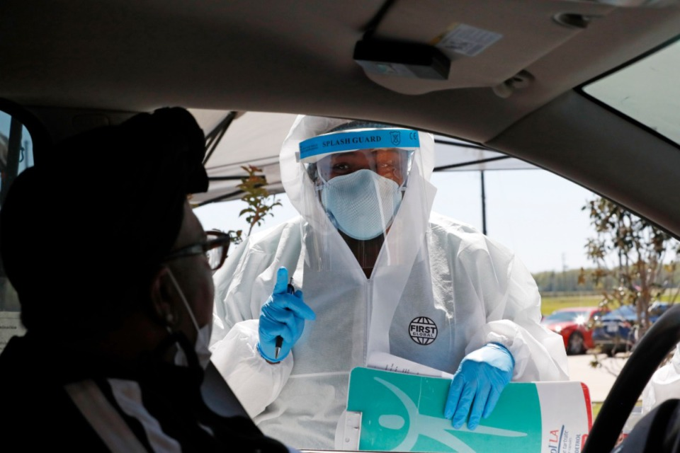 <strong>Dr. Marketta Blue, medical director of the Delta Health Center, questions a drive-up patient for COVID-19 testing at the center's Dr. H. Jack Geiger Medical Center in Mound Bayou, Mississippi, Thursday, April 16, 2020.</strong> (AP Photo/Rogelio V. Solis)