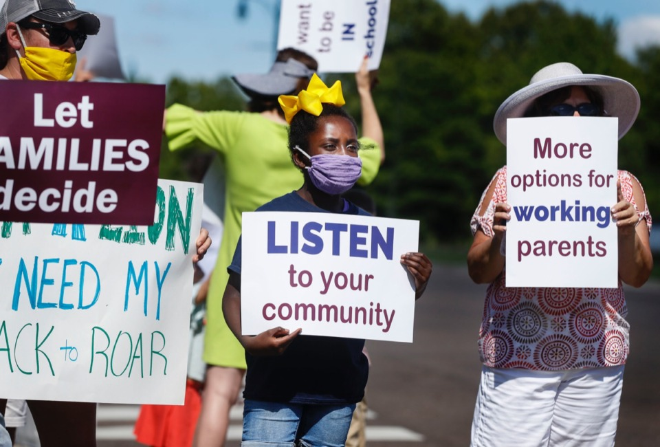<strong>Madison Rice, 9, (middle) attends a protest against the district's new reopening plan on Monday, July 27, 2020, outside Collierville High School.</strong> (Mark Weber/Daily Memphian)