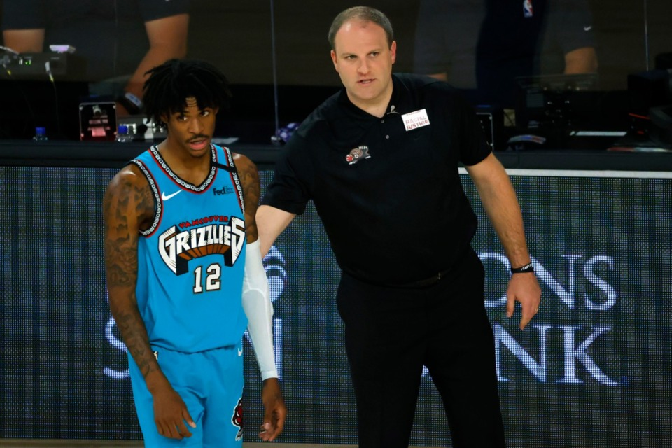 <strong>Memphis Grizzlies' Ja Morant (12) and head coach Taylor Jenkins look on against the Utah Jazz Wednesday, Aug. 5, 2020, in Lake Buena Vista, Fla.</strong> (Kevin C. Cox/Pool Photo via AP)