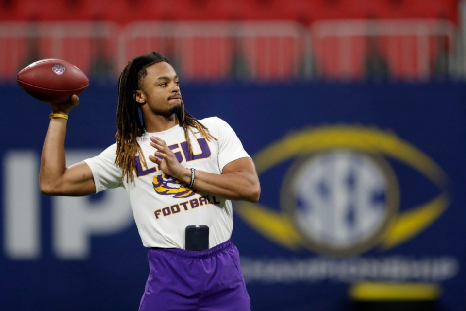 <strong>Peter Parrish (8) throws a pass during a practice ahead of Saturday's SEC Championship NCAA college football game against Georgia, Friday, Dec. 6, 2019, in Atlanta.</strong> (AP Photo/John Bazemore)