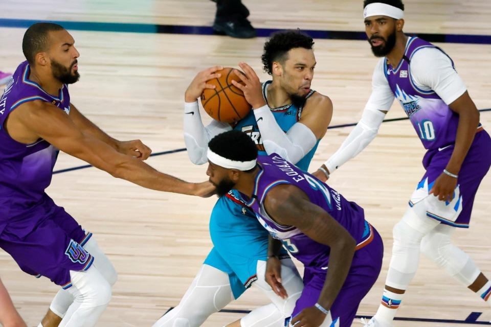 <strong>Memphis Grizzlies' Dillon Brooks (24) battles a scrum of Jazz defenders Wednesday, Aug. 5, 2020, in Lake Buena Vista, Fla.</strong> (Kevin C. Cox/Pool Photo via AP)