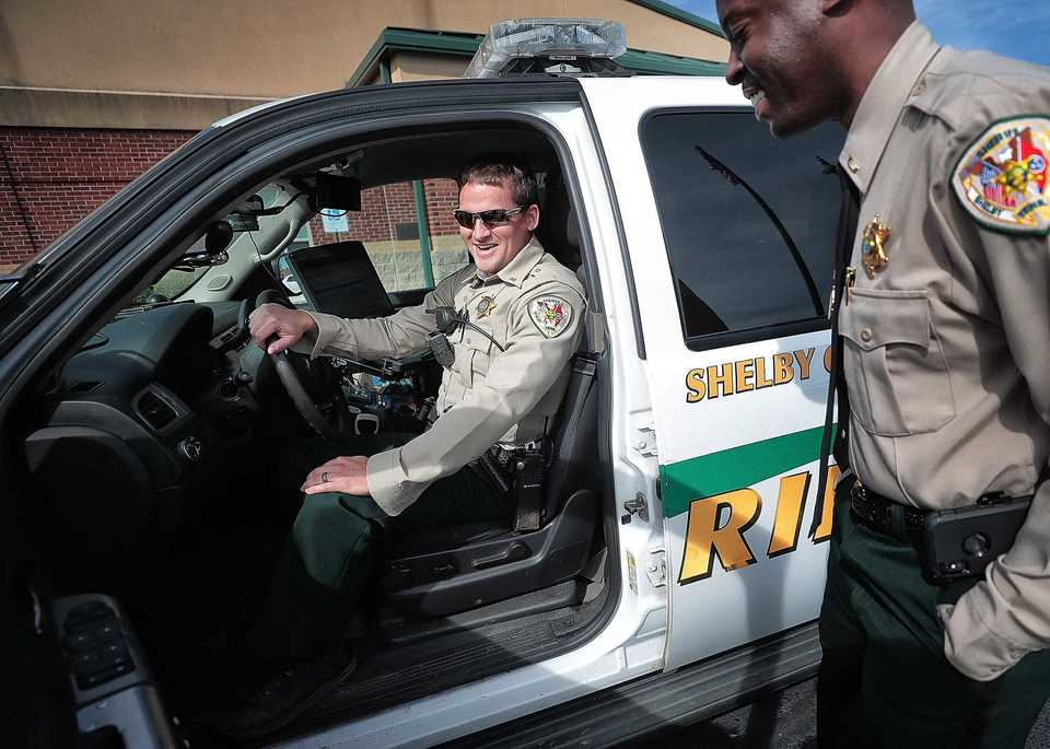 <strong>Shelby County Sheriff's Lt. Anthony Buckner (right) talks with Deputy Andrew Sanford at the Arlington substation on Oct. 23, 2018. Sanford is one of the first 100 deputies to be outfitted with a body camera as the sheriff's office slowly rolls out 300 new cameras for its deputies. The department hopes that by the beginning of 2019 all 300 deputies who respond to calls have both body cameras and in-car cameras.</strong> (Jim Weber/Daily Memphian)