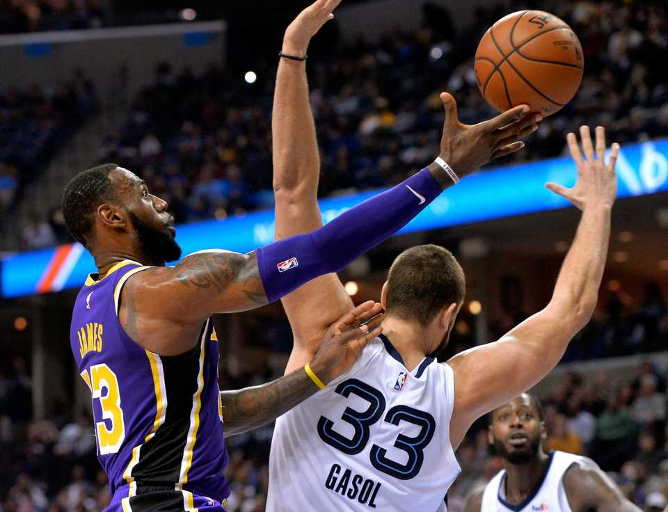 <strong>Los Angeles Lakers forward LeBron James, left, shoots against Memphis Grizzlies center Marc Gasol (33) in the second half of an NBA basketball game on Saturday, Dec. 8, 2018, in Memphis, Tenn.</strong> (AP Photo/Brandon Dill)