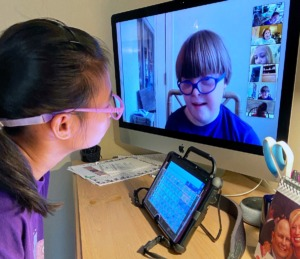 <strong>Madonna Learning Center students Hannah and Murphy video chat with each other as a way to stay in touch while school is closed.</strong> (Submitted)