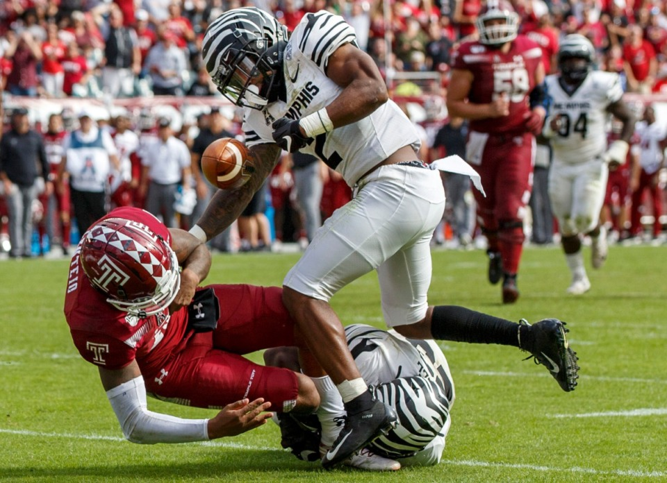 <strong>Memphis defensive back T.J. Carter strips the ball from Temple quarterback Todd Centeio during their game&nbsp; on Oct. 12, 2019, in Philadelphia. Carter returns to the Tigers&rsquo; roster this season as a senior.</strong> (Chris Szagola/Associated Press file)