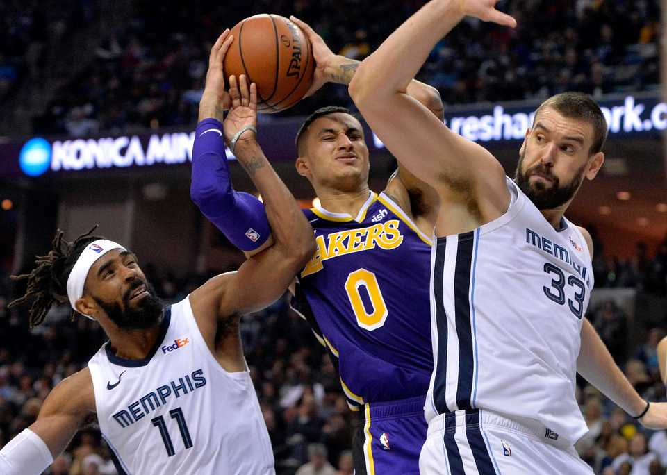 <strong>Los Angeles Lakers guard Lonzo Ball (2) struggles for control of the ball against Memphis Grizzlies guard Mike Conley (11) and center Marc Gasol (33) in the first half of an NBA game on Saturday, Dec. 8, 2018, in Memphis.</strong> (AP Photo/Brandon Dill)