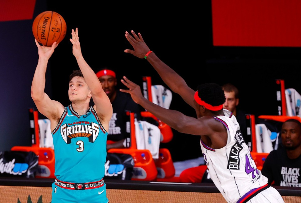 <strong>Grayson Allen, left, of the Memphis Grizzlies' attempts a three-pointer against Toronto Raptor Pascal Siakam, right, Aug. 9, 2020, in Lake Buena Vista, Fla.</strong> (Kevin C. Cox/Pool Photo via AP)