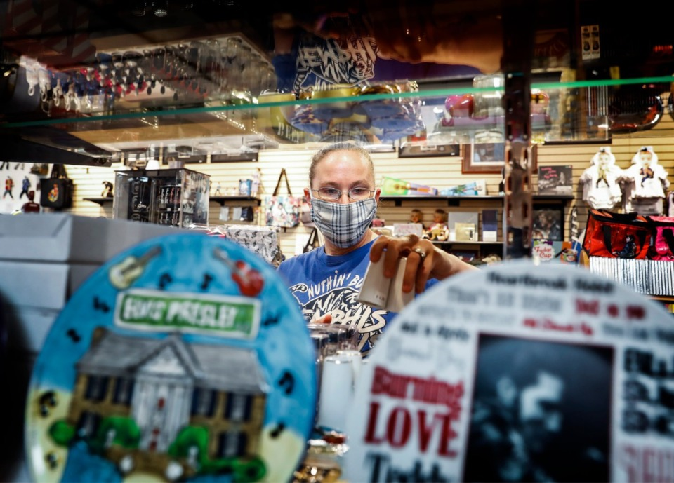 <strong>Boulevard Souvenirs employee Colleen Brown stocks the store shelves with salt and pepper shakers on Monday, May 4, 2020.</strong> (Mark Weber/Daily Memphian file)