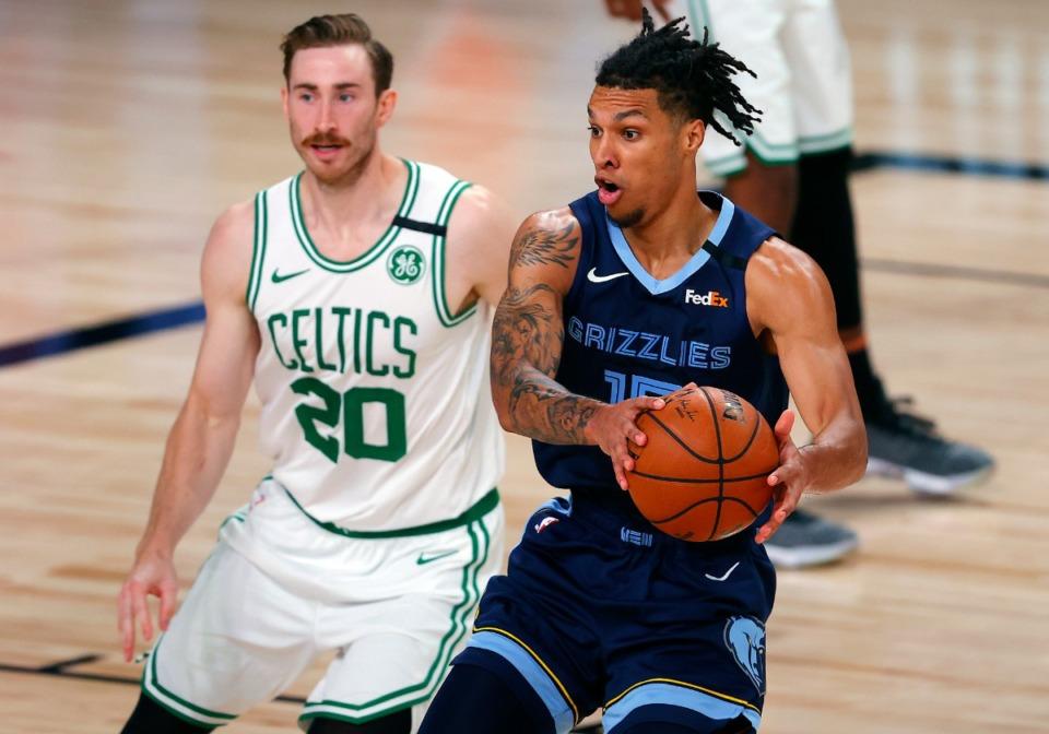 <strong>Memphis Grizzlies' Brandon Clarke (15) handles the ball as Boston Celtics' Gordon Hayward (20) defends during the second half of an NBA basketball game Tuesday, Aug. 11, 2020, in Lake Buena Vista, Fla.</strong> (Mike Ehrmann/AP photo via pool)