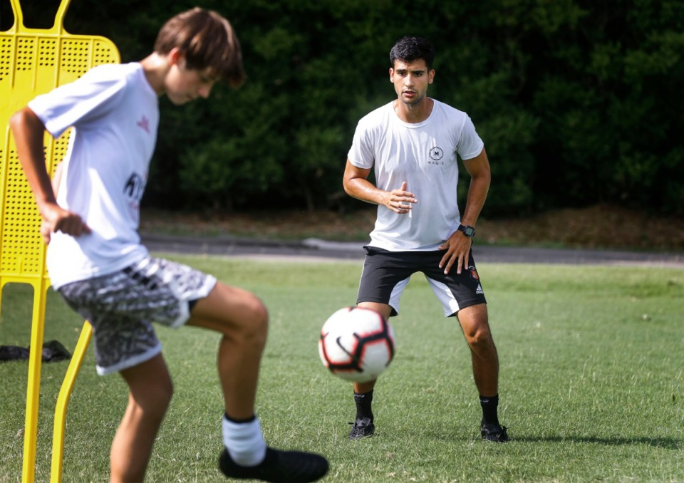 <strong>Former University of Memphis soccer player Hector Cantele (right) trains Clayton Somogyi (left) on July 23, 2020, at Christian Brothers High School. Cantele recently founded a new academy to help underprivileged youth.</strong> (Mark Weber/Daily Memphian)