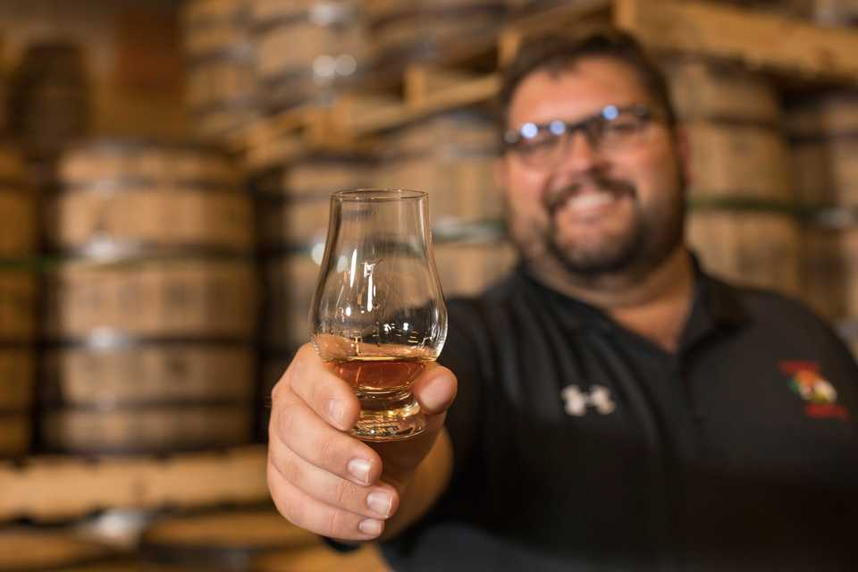 <strong>Ryan Trimm shows off the first pour of his new barrel of Memphis-made Blue Note Bourbon.&nbsp;</strong><span>(Photo by Justin Fox Burks, courtesy of Sweet Grass)</span>