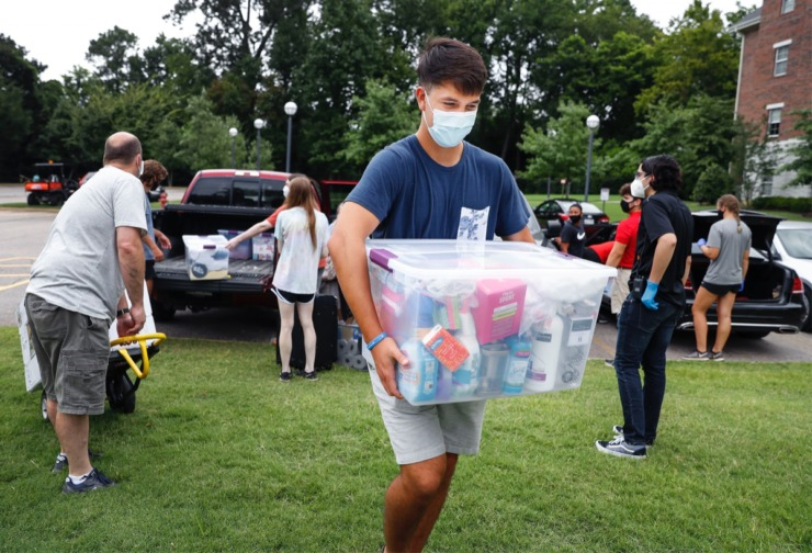 <strong>Christian Brothers University student volunteer Alvaro Martinez (middle) helps bring supplies into the dorms during freshman move-in day on Tuesday, August 11, 2020.</strong> (Mark Weber/Daily Memphian)